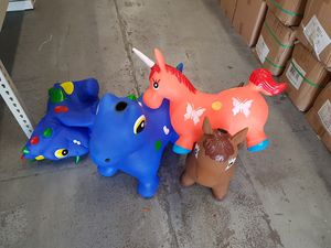 Kids ride jumping toy with music, horses, unicorn and dinasur. for Sale in Houston, TX