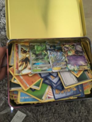 Pokemon sun and moon booster box and lunch pale filled with Pokémon cards for Sale in Covina, CA