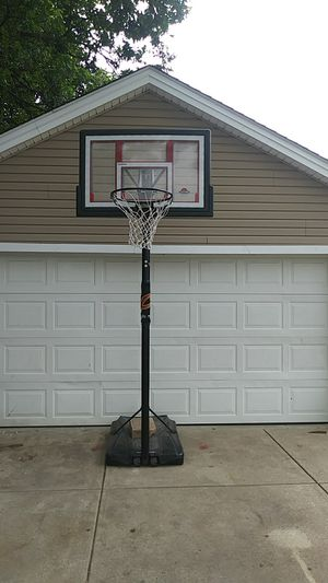This is an adjustable basketball hoop adjust from 6 ft to 10 ft for Sale in East Cleveland, OH