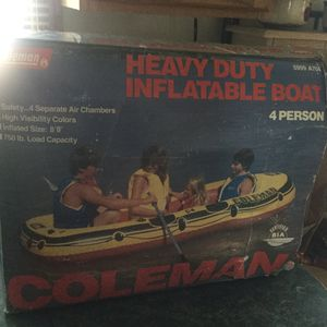 Brand new Coleman Heavy Duty Inflatable 4 person boat. Never used. Full featured repair kit, high visibility colors, carrying handles, oar holders for Sale in Plainfield, IL