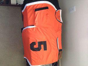 Two orange white black soccer jerseys for Sale in Tacoma, WA