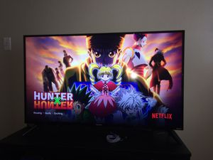 50 inch smart tv great condition with PS4 1tb with controllers/games and tv stand for Sale in Nashville, TN