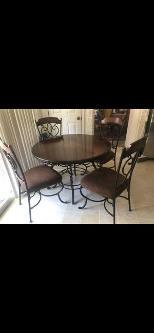 Ashley furniture dinning table with 4 chairs for Sale in Lathrop, CA