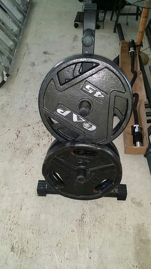 Four 45 pound olympic plates plus weight tree for Sale in Elk Grove Village, IL