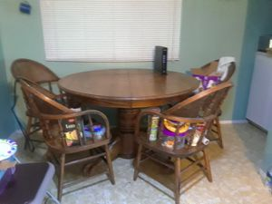 Solid oak dining table with leaf and 4 barrel chairs. for Sale in Federal Way, WA
