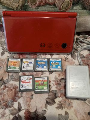 Nintendo Dsi XL. W/6games & charger for Sale in Long Beach, CA