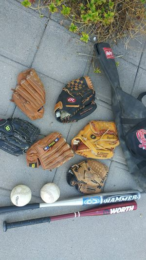 4 Kid's Gloves and 1 adult glove, 2 Bats,2 softballs and 1 Rawlings bag. $25 for all of it. for Sale in Phoenix, AZ