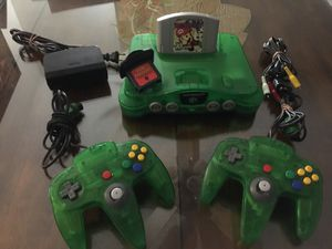 Green clear Nintendo 64 w Mario Party w2 original Controllers and Cables for Sale in National City, CA