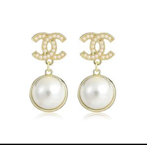 Cc gold and pearl dangle stud earring for Sale in Clearwater, FL