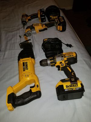 I am selling this hammer drill or impact drill tool with a large battery and charger. And a multipurpose saw. everything in perfect condition. for Sale in Manassas, VA