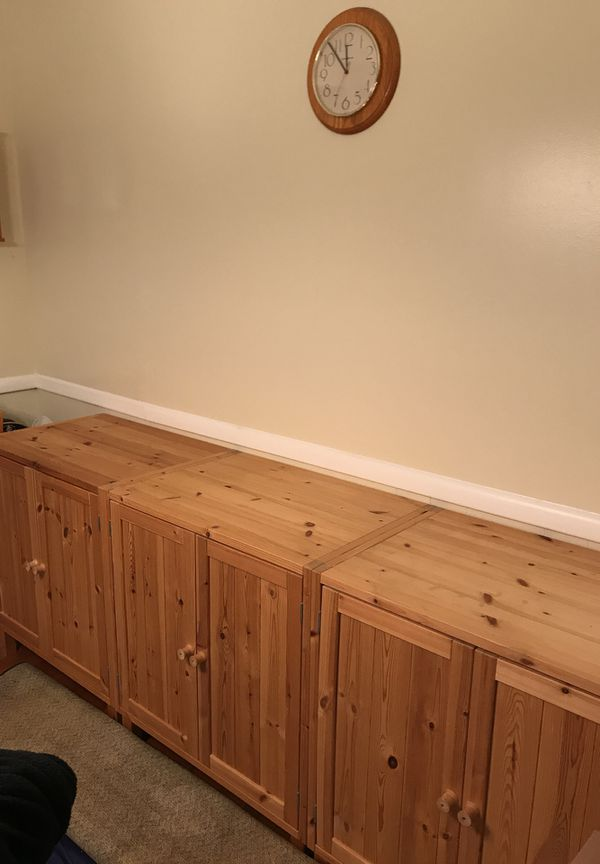 3 cabinets with 1 shelf inside