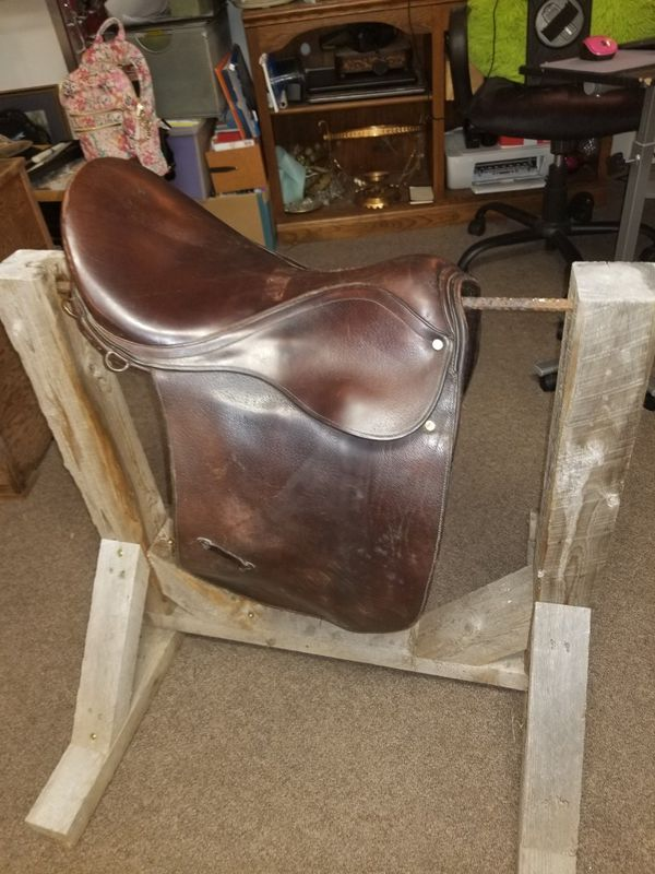 2 saddles, a saddle holder, stirrups & a large tack box W/ horse blankets