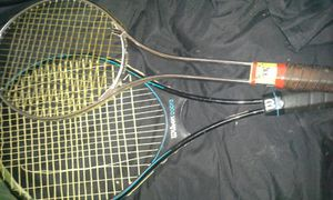 Two tennis rackets one made by russell and wilson for Sale in Suitland-Silver Hill, MD