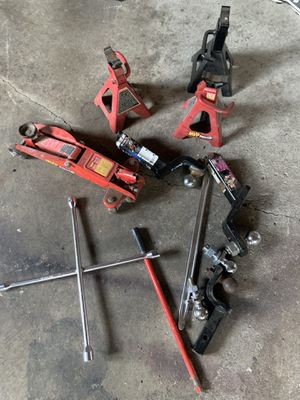 Tire iron , MVP super lift hydraulic Jack, 5 trailer hitch balls , 3 jack stands , 2 Trailer Hitches for Sale in Sterling Heights, MI