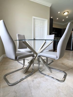 BRAND NEW MODERN GLASS DINING TABLE !! LEATHER CHAIRS WITH CHROME LEGS !! PAID $800 !! for Sale in Miami Gardens, FL