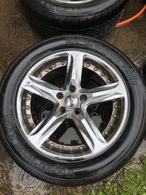 16 4-16 in pulse chrome rims with 2 worn 215/55/16 bf goodrich tires for Sale in Taylor, MI