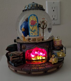 Disney Beauty & The Beast light-up Musical Snowglobe Fireplace collectible Globe Statue for Sale in Placentia, CA