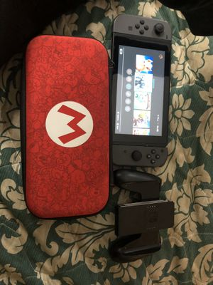 Nintendo switch with carry case and joy con grip controller for Sale in Atlanta, GA