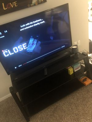 Black glass TV stand for Sale in Silver Spring, MD