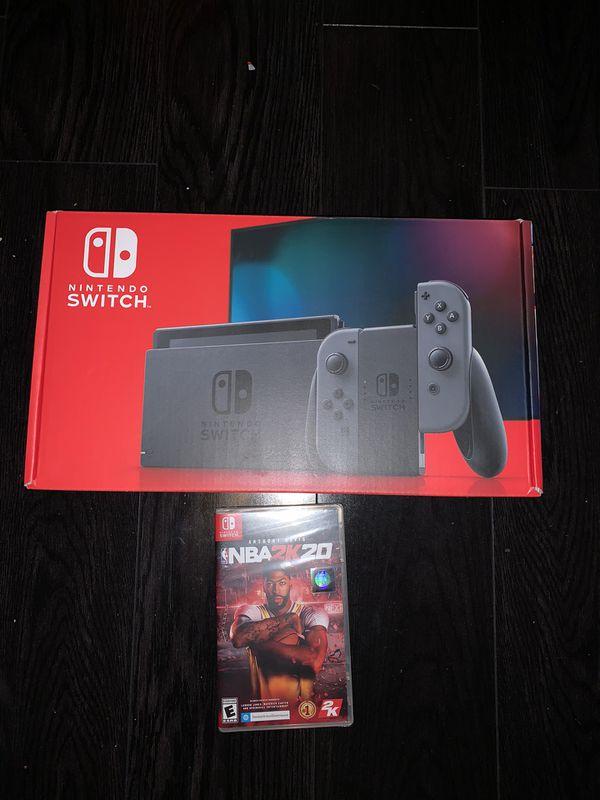 Nintendo switch brand new V2 with nba 2k 20 both new sealed