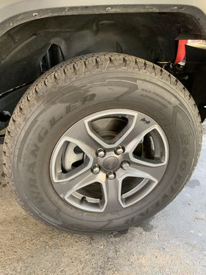 Goodyear wrangler tires with original Jeep wheels for Sale in Fresno, CA