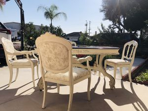 Solid wood dining table with four chairs for Sale in Cypress, CA