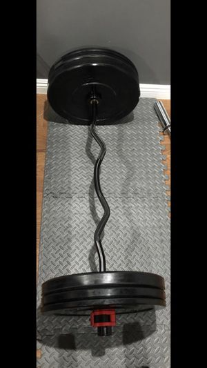 Olympic curling barbell with pairs of 25s, 15s, and 10s of Bumpers/ Olympic Rubber Weights/ Plates for Sale in San Gabriel, CA
