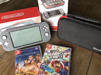 Like New Nintendo Switch Lite with boxes and 2 Games. (Civilizaton 6, Mario Party) for Sale in Oklahoma City,  OK
