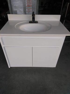 Double door solid wood white single sink brand new and double sink cabinet white. Brand new for Sale in Glendale, AZ