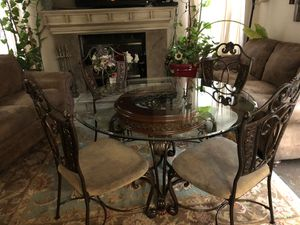 By Ashley furniture. Beautiful dining room table with four chairs heavy if you would like a table to last you a lifetime this is the one for you. for Sale in Modesto, CA