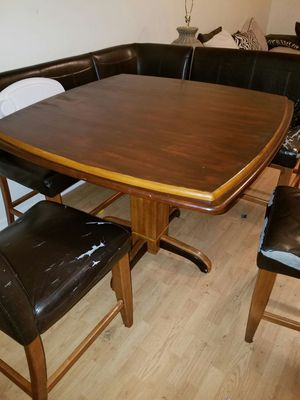 Very solid table chairs and bench has damage for Sale in Cleveland, OH