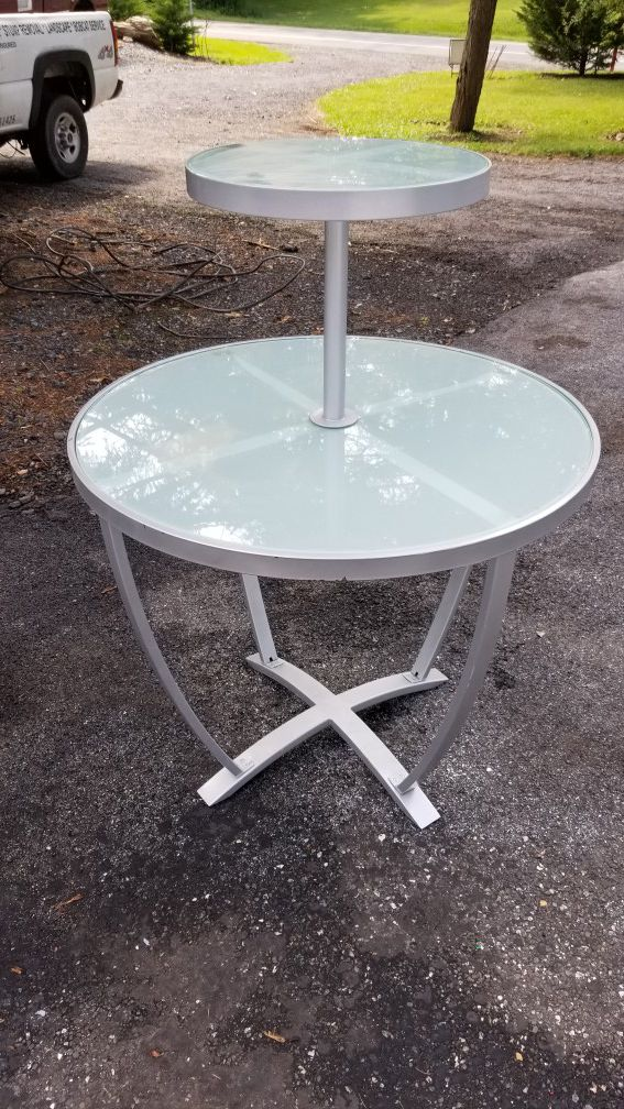 Glass and metal display stand, tables.