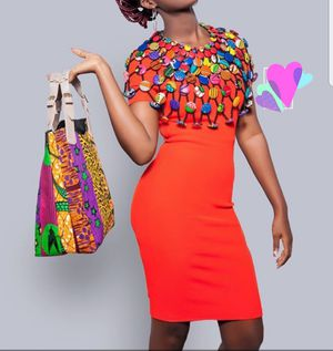 Buttons and beads cape and quality handmade leather bag covered with Ankara fabric. for Sale in Baltimore, MD