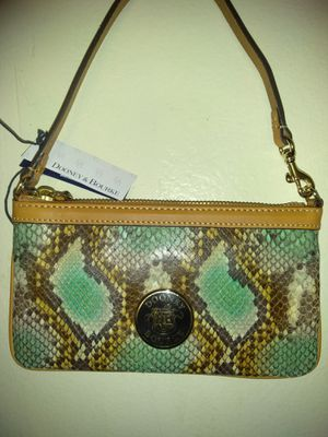 Authentic Dooney and Bourke Snakeskin Wristlet for Sale in Jacksonville, FL