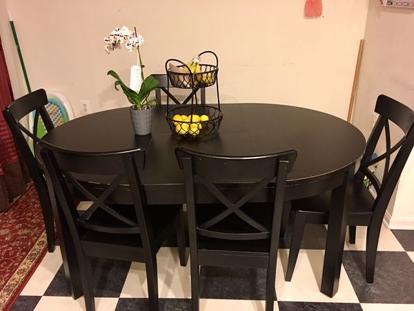 Dark brown wood dining table for sale.