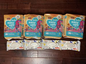 FOUR Pampers Easy Ups Pull Ups & FOUR Huggies Wipes $30 for Sale in Queens, NY