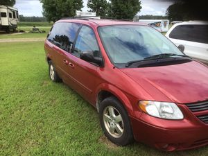2006 Dodge Grand Caravan, with back seat that lowers and hooks into a wheelchair base to become a wheelchair! for Sale in Williamston, NC