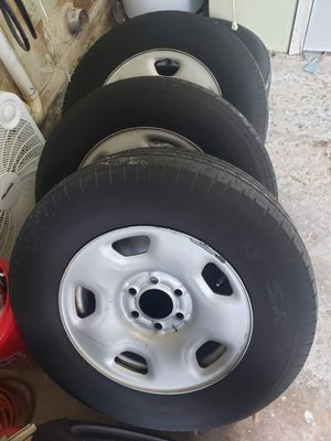 Ford 6 lug wheels and tires with hubcaps for Sale in Tampa, FL