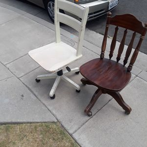 Two Wood Rolling dezk chairs for Sale in Huntington Beach, CA