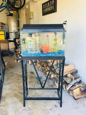Aquarium for sale ! Comes with Air filters, pumps, heaters and stand. 10 gallons. Comes with fluorescent light for glow fish - DM for any additional for Sale in Saginaw, TX
