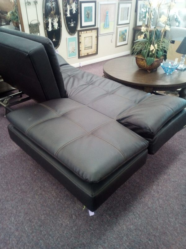 Like New Leather black futon sofa bed adjusts