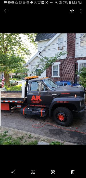 For sale ford F600 flatbed rollback tow truck for Sale in Dover, DE