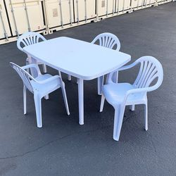 """$80 (new in box) plastic table and 4pc armrest chairs set outdoor patio furniture, table 54x33x28"""", chair 17x19x34"""" for Sale in Whittier,  CA"""
