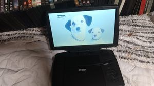 RCA portable DVD player with LOTS of DVDs for Sale in Seattle, WA
