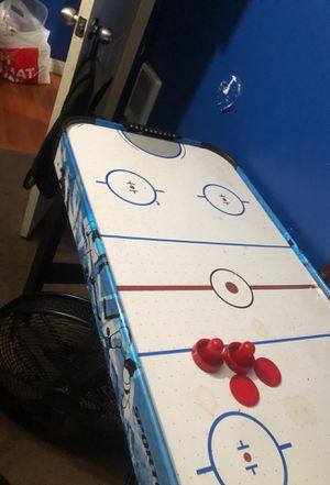 Pictures are just to show but Brand new in box home Air hockey table for Sale in Lomita, CA