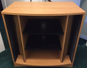 Entertainment center with adjustable shelves and lots of slotted space for DVDs and CDs for Sale in Skaneateles, NY
