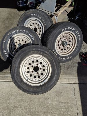 5lug Chevy truck aluminum wheels .. tires hold air but weather check for Sale in Sumner, WA