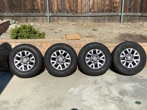 Toyota Tacoma Set Of Tires And Rims (stock aluminum rims for 2016 SR5) for Sale in Claremont, CA