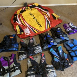 9 Life jackets and large riding tube for jet skies or boat. All like new only used once . First with $125 takes it all for Sale in San Antonio, TX