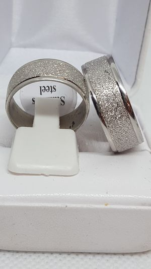 Brand new. Sizes 7 and 12 available. Never tarnish wedding rings. Solid 316l stainless steel. for Sale in St. Louis, MO